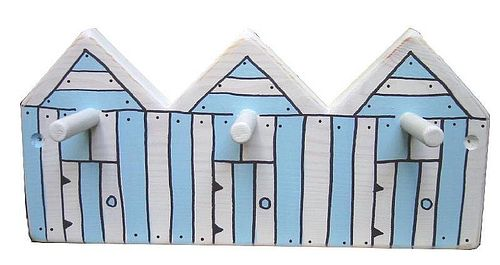 Kid's wall pegs fashioned in a style of beach huts