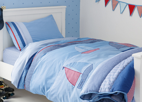 Kid's pale blue bedding with sailboats