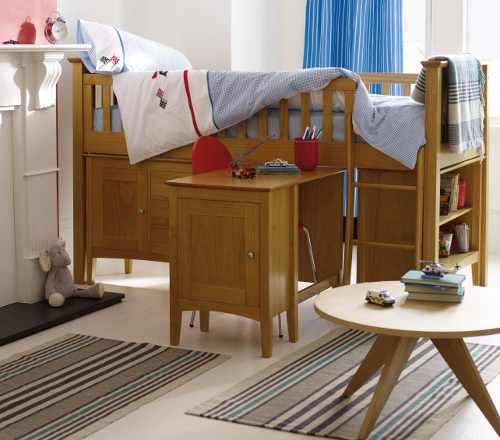 Children's cabin bed with combined storage and pull-out desk