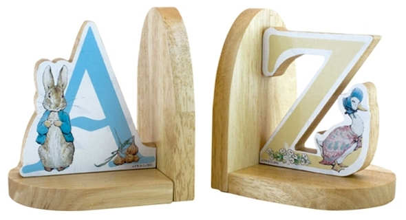 Wooden bookends with Peter Rabbit standing by the 'A', and Jemima Puddle-Duck standing by the 'Z'