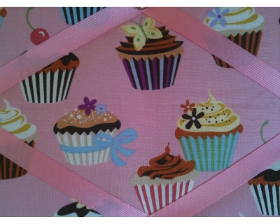 Pink notice board with cupcakes design