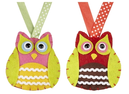 Cute owl decorations hung from a dotted ribbon