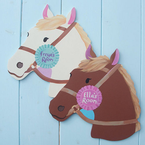 Horse design name signs with a pink or blue rosette