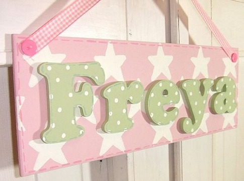 Stars design name plaque hung from a pink gingham ribbon