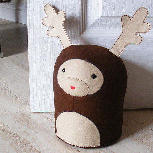 Children's door stop in the shape of a cute little reindeer