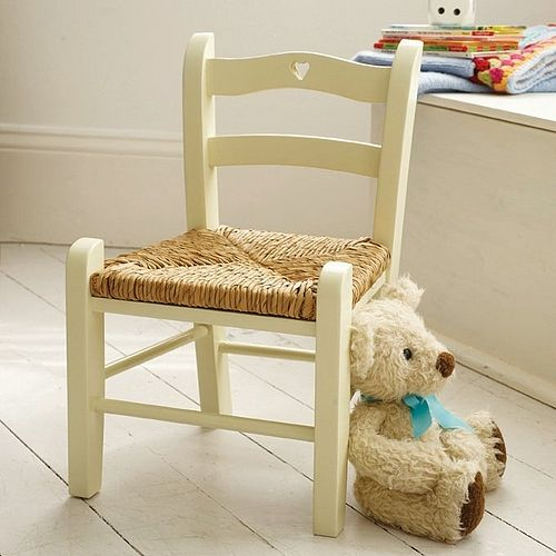 Child's painted wooden chair with woven rush seat pad