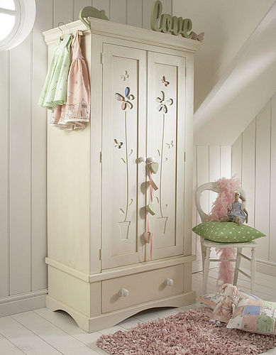 Solid wood wardrobe with flower pot carved out of the door and fabric backing