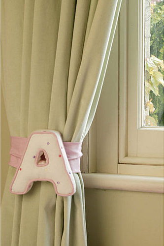 Personalised letter used as a curtain tie-back