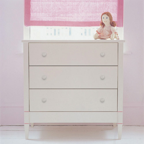 Wooden chest of drawers painted in soft ivory