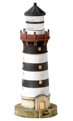 A table lamp fashioned to look like a lighthouse